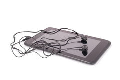 Black tablet PC and headphones (Clipping path) Royalty Free Stock Photos