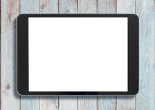Black tablet pc looking similar to ipad on old white wood background. Black tablet pc looking similar to ipad on white wood background Royalty Free Stock Photography