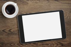 Black tablet pc on table desk with coffee cup Royalty Free Stock Photo