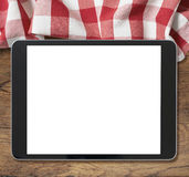 Black tablet pc on wooden table and picnic Stock Photo