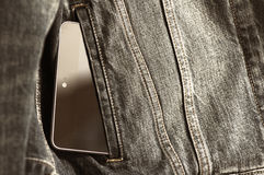 The black tablet in a pocket Stock Photos