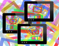Black tablets with abstract colorful pictures Stock Image