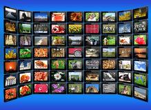Black tablets with motley pictures on the blue Royalty Free Stock Photography