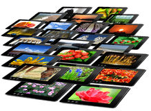 Black tablets with motley pictures isolated Stock Photos