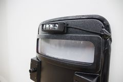 Black tactical ballistic shield with flash light isolated on whi. Close up black tactical ballistic shield with flash light for S.W.A.T or law enforcement attack Royalty Free Stock Photography