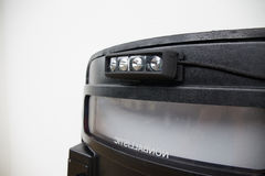 Black tactical ballistic shield with flash light  on whi Stock Photos