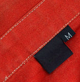 Black tag on a clothes royalty free stock photos