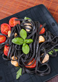 Black tagliolini pasta Royalty Free Stock Images