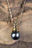 Black Tahitian Pearl. Black Tahitian pearl mounted in 18 karat gold stock photos