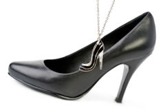 Black tall shoes and necklace Royalty Free Stock Photography