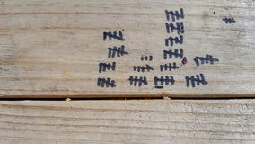 Black tally marks on wood Stock Image