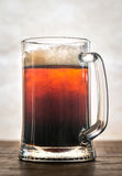 Black and Tan beer cocktail. Black and Tan - beer cocktail of pale and dark beer in the mug Stock Photos