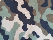 Black, tan, and green camouflage carpet Stock Photography