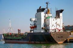 Black tanker loading Royalty Free Stock Image