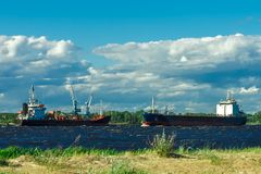 Black tanker ship. Black cargo tanker ship moving past the cargo port Stock Photos