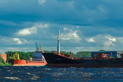 Black tanker ship. Black cargo tanker ship moving past the cargo port Royalty Free Stock Photography