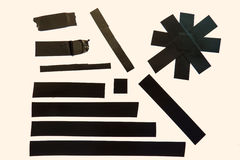 Black Tape Pieces. A collection of black adhesive tape pieces Royalty Free Stock Photo