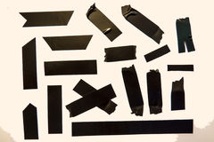 Black Tape Pieces. A collection of black adhesive tape pieces stock images