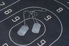 Black target with blank dog tags Royalty Free Stock Photography
