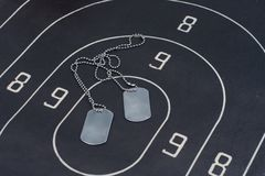 Black target with blank dog tags Royalty Free Stock Images