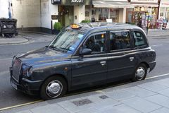 The black taxi in London, England. LONDON-ENGLAND-JAN 20, 2017: The black taxi is a famous London icon that was first introduced at the turn of the 20th century stock image