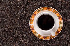 Black Tea. Dried black tea leaves and a cup of black tea Stock Photography