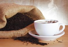 Black Tea. Cup of Black Tea and Dry Leaves Still Life royalty free stock photography