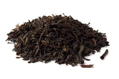 Black tea. Heap of dried black tea leave isolated on white royalty free stock images