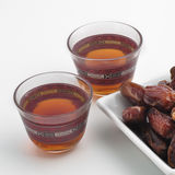 Black tea_2 cups. Two cups of black tea with a bowl of ripped dates Stock Images