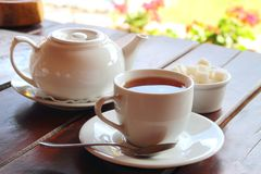 Black tea. Served on the wooden table Stock Images