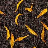 Black tea. Loose dried tea leaves and sunflower petals stock photography