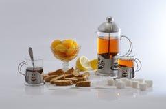 Black tea with apricot halves Royalty Free Stock Photo