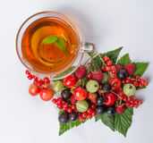 Black tea with assorted berry Royalty Free Stock Photos