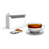 Black tea bags with cup with and tea box Royalty Free Stock Photography