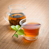 Black tea. On a bamboo mat Royalty Free Stock Photos