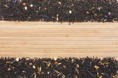 Black tea   on  a   bamboo  mat Stock Photography
