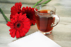 Black tea and beautiful flowers Royalty Free Stock Image
