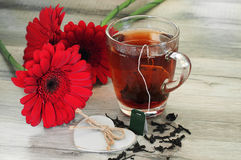 Black tea and beautiful flowers Royalty Free Stock Images