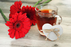 Black tea and beautiful flowers Royalty Free Stock Photo