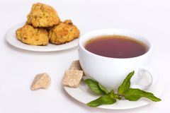 Black tea with biscuits Stock Photos