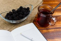 Black tea and blackberries for healthy meal stock images