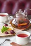 Black tea with blackberries, mint and lemon stock photography