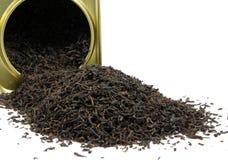 Black tea box. Black tea spilling out of a tea box Stock Photo