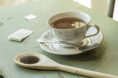 Black Tea. British black tea in a dainty tea cup and saucer Stock Images