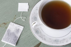 Black Tea. British black tea in a dainty tea cup and saucer Stock Image