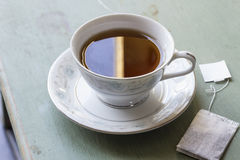 Black Tea. British black tea in a dainty tea cup and saucer Royalty Free Stock Photo
