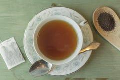 Black Tea. British black tea in a dainty tea cup and saucer Stock Photo