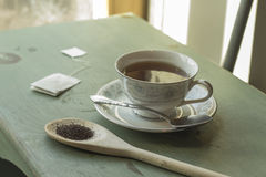 Black Tea. British black tea in a dainty tea cup and saucer Royalty Free Stock Photography