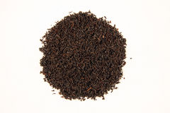 Black tea. A bunch of black tea on a white background Royalty Free Stock Images