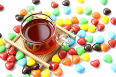 Black tea and candy Royalty Free Stock Photography